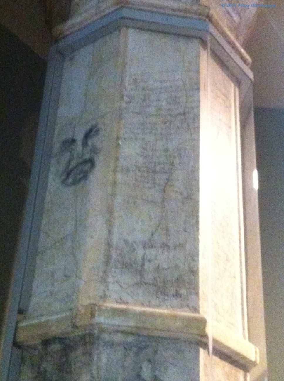 During the long wait in line at Ellis Island, new Americans drew grafitti on the pillars.  I am moved by the image of angst on the upper left of this image.