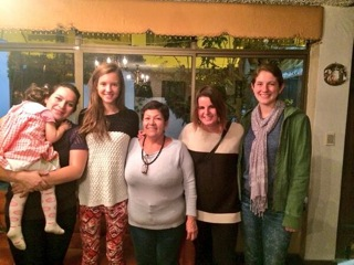 Pip and education abroad students with her host mom and an Ecuadorian friend.