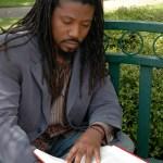 Melvin Bray on bench reading