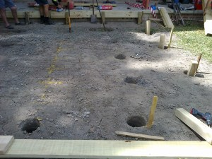 Lots of holes at Silver Ridge Community Cottage, foundations for the new sun deck.