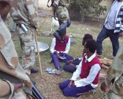 TPLF soldier kicks Oromo high school student in the head