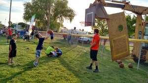 There will be many games at the Family Fun Night this year, including the possibility of this one, shooting basketball hoops on the grass. Photo by Stephanie Frehner.