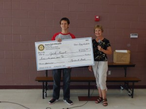 Zack Hurt, Beaver Dam High School senior was awarded the Mesquite Rotary's $500 scholarship based on GPA, school involvement and being an Interact Club member.  Hurt also had to compete in an essay competition for the scholarship.  Pictured is Linda Gault, Rotary Member presenting Hurt with the $500 check.  Submitted Photo