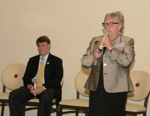 AD 19 candidate Connie Foust addresses the Forum as Assemblyman Chris Edwards looks on.