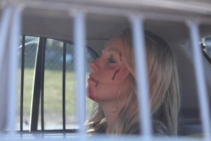 The 'drunk driver' of the 'Every 15 Minute' program sits in the back of the Mesquite Police car waiting for her trip to jail for her staged drunk driving accident.  Photo by Teri Nehrenz