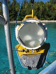 -The huge helmets are lifted on and off the divers with a wench.
