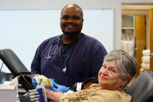 Red Cross employee Darryl Thompson sets up long time blood donor Lois West in her first visit to the Primex location during their annual blood drive held on June 2.  Photo by Teri Nehrenz