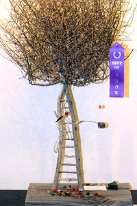 The Last Harvest, a mixed media piece, by Judith Hetem won 'Best of Show' at the 'It's Surreal' exhibition held during the month of June at the Mesquite Fine Arts Gallery.  The exhibit was sponsored by the Bank of Nevada.  Photo by Teri Nehrenz