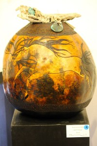 A carved gourd by artist Janet Trobough titled 'Runs with the Wind' is further adorned with native wood and turquoise stones.  Photo by Teri Nehrenz