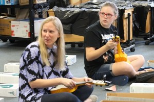 Virgin Valley Elementary School music Teacher Jenny Bennett and Jaelin Worthen unpack and tune 30 brand new Waterman Soprano Ukuleles donated to the class by Kala Music.  Photo by Teri