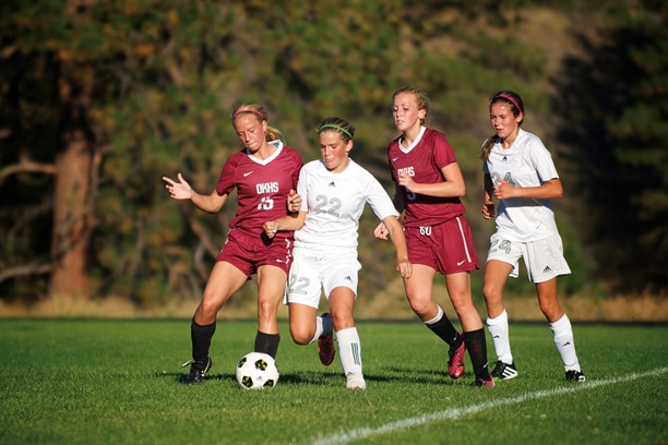 8th-grade starter Haley Post plays stout defense against Okanogan's strikers. Photo by E.A. Weymuller
