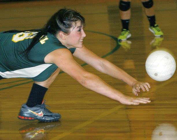 Junior Ashley Watson digs deep to get under a Tonasket serve during a four-game home stand against the Tigers last week. The Lady Lions won three of four games. Photo by Mike Maltais