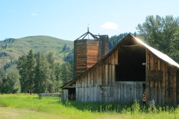WDFW compensates the county for properties it owns through the payments in lieu of taxes (PILT), but state budget cuts have reduced the amount the county receives by two-thirds. The PILT payments do not cover buildings, like this barn on a WDFW parcel south of Carlton. File photo by Marcy Stamper
