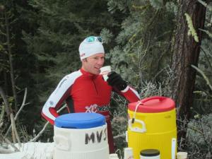 Tav Streit, Hood River, won the race with a time of 1:17:26. Here, he rehydrates after the race. Photo by Don Nelson
