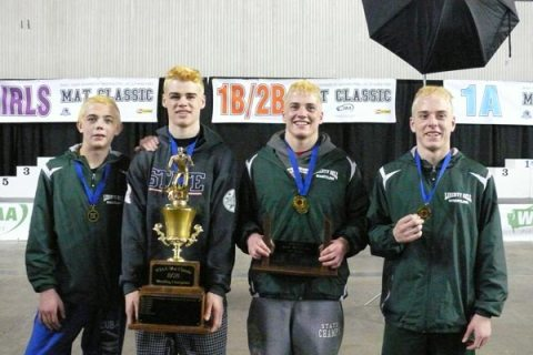Liberty Bell's four state champions: left, Trent Skelton, 120 pounds, Milo Holston, 160 pounds, Emmett Fink, 152 pounds, and Meritt Fink, 138 pounds. Photo by Callie Fink