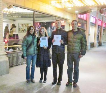 After Liam Daily won the Poetry Out Loud regional competition and Kira Cramer placed third, the group from Liberty Bell High School stopped outside the Bing Crosby Theater in Spokane. From left, Sara Mounsey, Kira Cramer, Liam Daily, and Adam Kaufman.