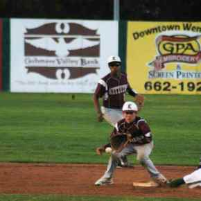 A late throw to second base is not in time to tag out baserunner Cole Darwood in the bottom of the seventh inning against Kittitas. Darwood would later score on a wild throw to third base to give Liberty Bell is fourth and final run of the game.Photo by Mike Maltais