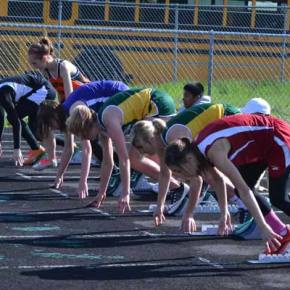 Lauren Fitzmaurice and Jessica Johnson launch out of the blocks in the 100-meter hurdles. Photo by Laurelle Walsh