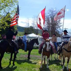 Ray Campbell, Tom Graves and Dennis Gardner present flags for the Methow Valley Rodeo. Photo by Laurelle Walsh