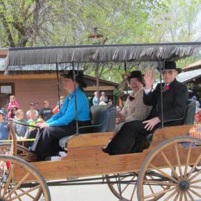 Kit McLean Cramer drives Grand Lady Lois McLean and Grand Marshal Ken Westman in the fringe-top carriage. Photo by Don Nelson