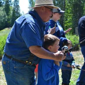 Skip Smith and grandson Jameson Smith get in some quality rod-and-reel time during  free fishing day for kids at the Winthrop National Fish Hatchery last weekend. Photo by Laurelle Walsh/i>