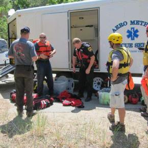Members of the Swiftwater Rescue Team get ready to go after Jessie. Photo by Don Nelson