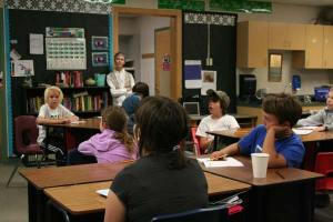 The third- and fourth-grade contingent listened attentively. Photo by Darla Hussey