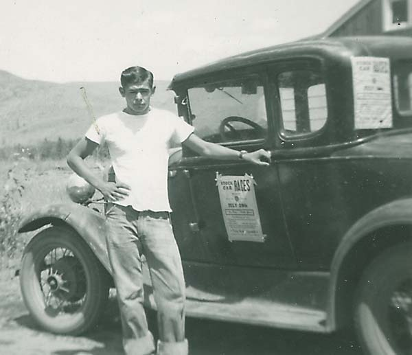 Vernon John Bame at age 16 with his first car.