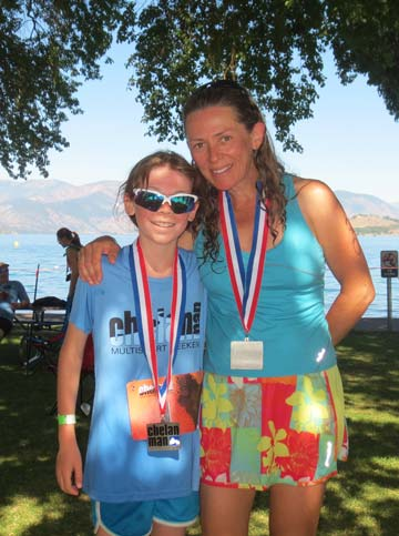 Liv Aspholm, left, poses with Methow Valley Elementary fifth-grade teacher Kelly van Bueren, who inspired the plucky youngster to enter the ChelanMan Try-a-Tri. Photo courtesy of David Aspholm,/i>