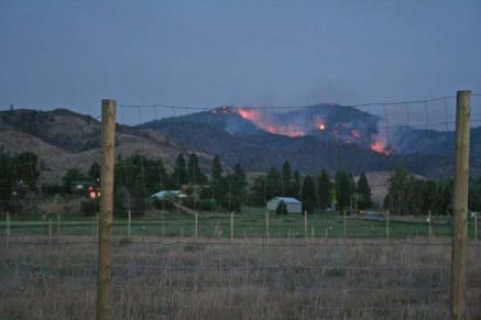 Monday night (July 28), the fire was still clearly visible looking towards Leecher Mountain from just south of the Highway 20 turn off. Photo by Darla Hussey