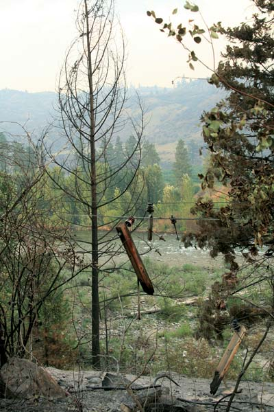 "Many parts of the power grid, like this transformer near Black Canyon, were destroyed by the fire. The most seriously damaged areas were in the lower Methow Valley and in the Chiliwist, where a PUD staffer said the power line had ""evaporated."" Photo by Marcy Stamper"
