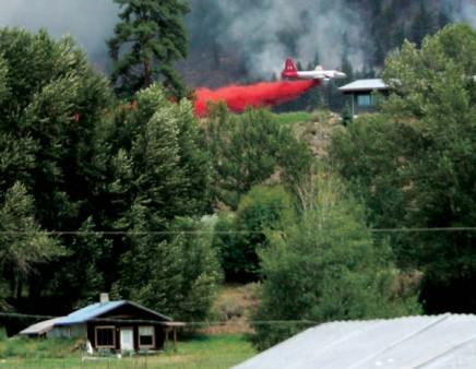 Planes were dropping fire retardant on the hills just south of Highway 20 on Friday afternoon.  Photo by Darla Hussey
