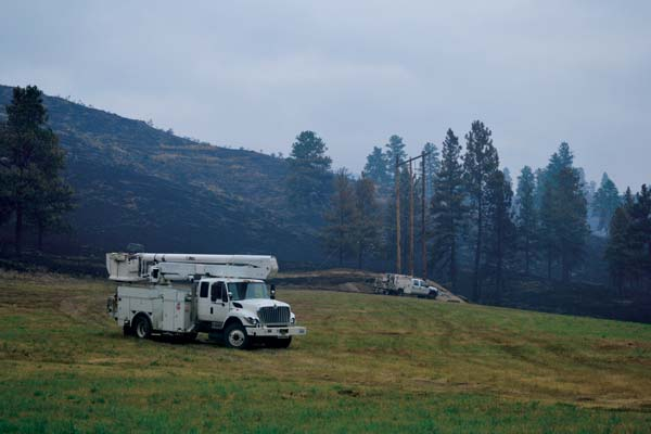 PUD crews had started replacing power poles on the Loup by Tuesday. Photo by Laurelle Walsh