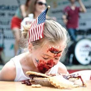 Photo by Mandi Donohue The face of the Fourth. A contestant in the pie-eating contest at the Methow Arts Festival demonstrated both patriotism and an effective — if messy — crust-attacking technique.