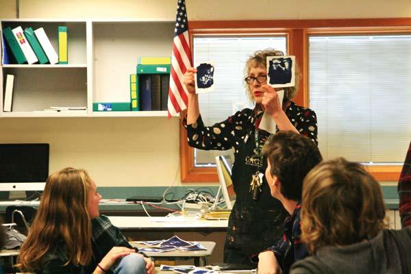 Photo by Marcy Stamper Art teacher Robin Nelson Wicks shows student work made with an old photo process.
