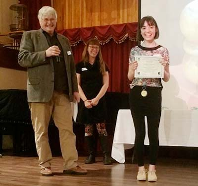 Photo courtesy of Liberty Bell Junior Senior High School Mia Stratman receives a first place in drawing and a best of show from Wenatchee Art and Cultural Museum curator Bill Rietveldt.