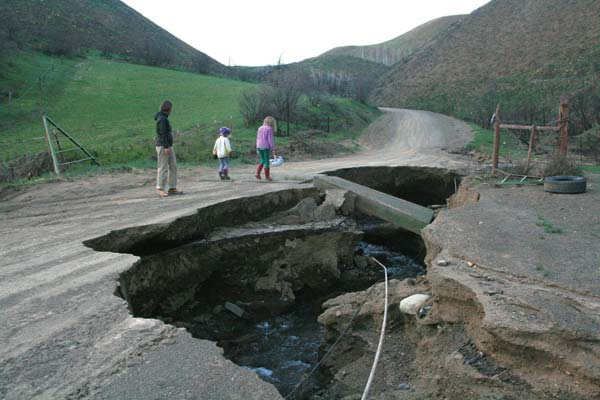 Photo by Marcy Stamper On Frost Road, heavy runoff, exacerbated by the destruction of vegetation on hillsides burned in the Twisp River Fire, has created massive craters and taken out a cattle guard.