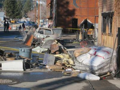 Photo by Don NelsonEquipment and supplies hauled out of the Twisp River Pub were piled up on the sidewalk after Monday's fire.
