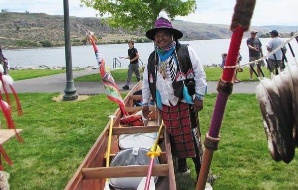 Photos by Joanna BastianDan Nanamkin stands by his team's cedar dugout canoe