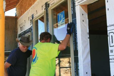 File photo by Marcy Stamper Jim Armstrong, left, and Mark Thompson, experienced volunteer builders from North Creek Presbyterian Church in Mill Creek, Washington, installed windows last July at a house on Finley Canyon. The house was completed and dedicated at the end of January.