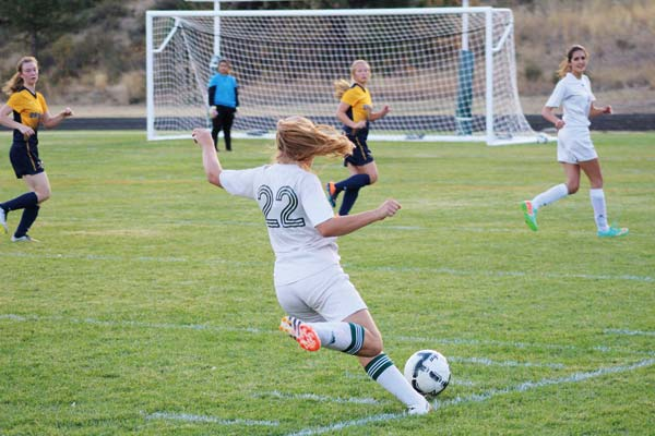 Photo by Don Nelson Liberty Bell's Haley Post (No. 22) scored a goal in each game last week.