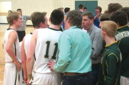 Photo by Don Nelson Liberty Bell coach Kyle Acord outlines strategy late in a close game against Manson.