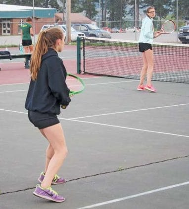Photo by Don Nelson Liberty Bell's Ruthann Matteson, left, and Erin Frey won their doubles match against Lake Roosevelt.