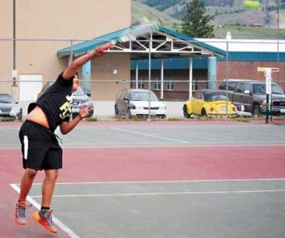 Photo by Don Nelson Alex Whites serves against Pateros.