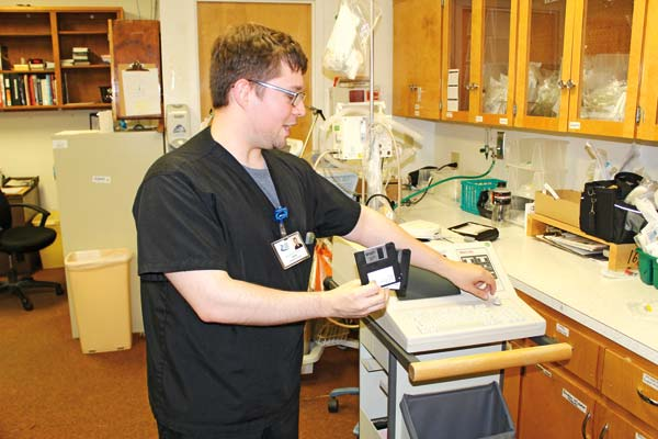 Photo by Don Nelson Barry Pentz, respiratory therapist at Three Rivers Hospital, with an older model EKG monitor that still uses floppy disks.