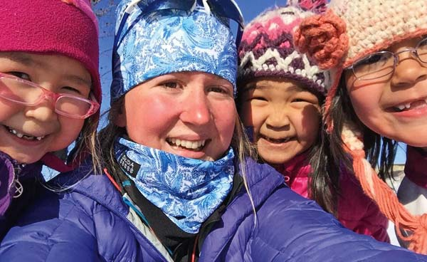 Photo courtesy of Taya Delong and Ella Hall Ella Hall with some of her Yup'ik friends in Alaska.