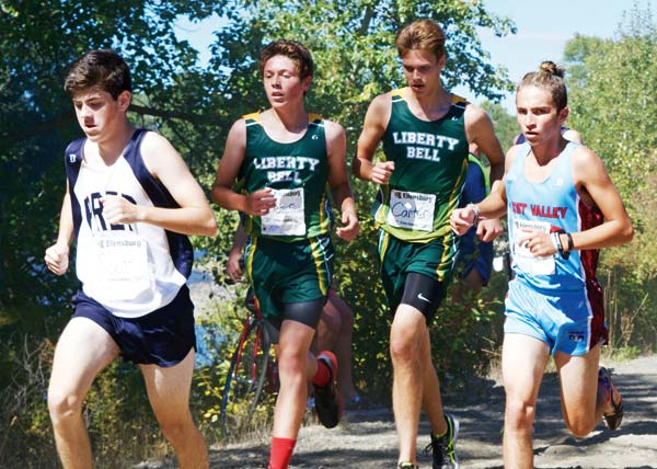 Photo courtesy of Erik Brooks Peter Aspholm, left, and Carter Dornfeld kept pace on the first loop of a 2.2-mile race at the Ellensburg Invitational.