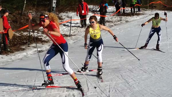 Photo courtesy of Cris Himes MVNT members Claire Waichler, left, and Ella Hall, center, raced in the hill climb relay at Cable, Wisconsin.