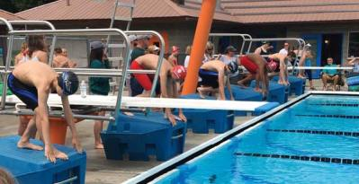 Photo courtesy of Keri MilesSwimmers poised for the start of a boys' 11-12 race at the Okanogan meet.