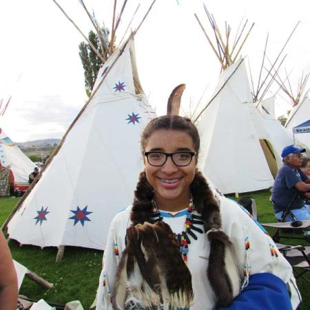 Photo by Joanna Bastian Aleeka Smith at the 2016 Indian Encampment at the Omak Stampede, wearing her great-auntie Mary's ceremonial white buckskin dress.